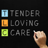 """blackboard with the words: """"Tender, Loving, Care"""""""