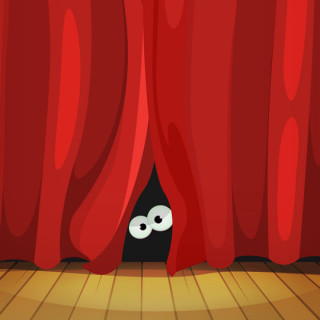 Two eyes peeking out from behind a theater curtain