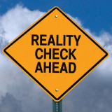 """Warning sign with words """"Reality Check Ahead"""""""