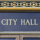 """words """"City Hall"""" over entry door"""