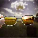 photo of countryside seen through pair of sun glasses