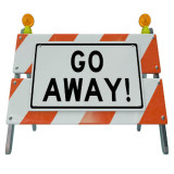 """Road barrier with words: """"Go Away!"""""""
