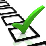 graphic of checklist with green check mark