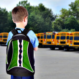 school boy looking at fleet of school buses.