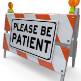 Construction warning sign: please be patient