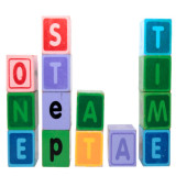 """stack of building blocks spelling out """"one step at a time"""""""
