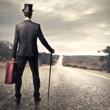 illustration of man in suit walking down a deserted road