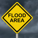 """road sign that says """"flood area"""""""