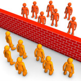 graphic of brick wall separating people on both sides