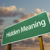 """road warning sign with words """"Hidden Meaning"""""""