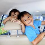 children in back seat of a car