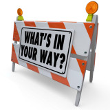 "image of road barrier that says ""What's In Your Way?"""