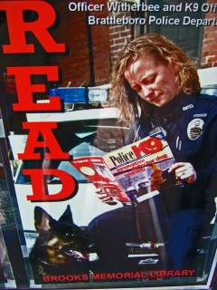 Brattleboro police officers like to read at the library