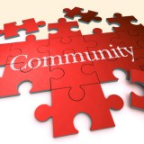 Illustration of a jigsaw puzzle with the word Community in the middle
