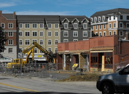 Demolition of strip shopping plaza at Storrs Center.
