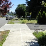 A sidewalk ends in this newer part of Portland, Oregon.