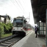 MAX light rail train arriving at Orenco Station from Hillsboro, heading to Portland and Gresham.