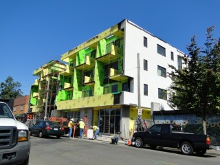New mixed-use development along a bus route in southeast Portland.