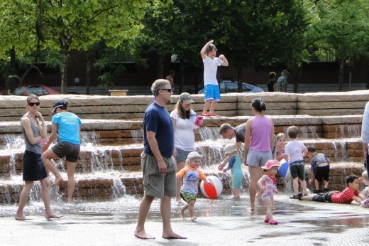 Playing in the water in Jamison Square