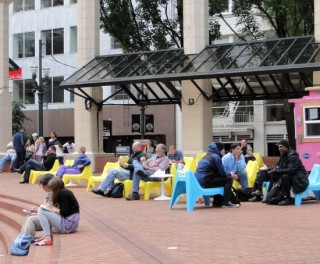 People sitting and talking in Pioneer Courthouse Square.