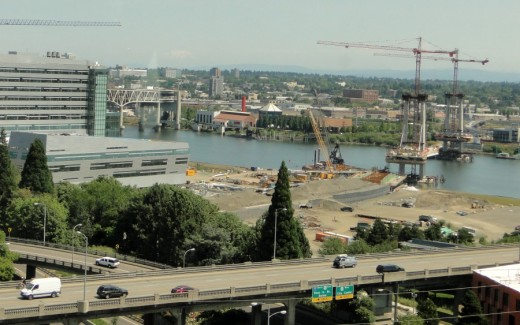 """View from Portland's aerial tram towards the Willamette River. The new """"Caruthers Bridge"""" will host the  7.3-mile MAX light rail Orange Line, when it opens in September 2015. Pedestrians. Only trains, buses, streetcars, pedestrians and bicyclists will be able to use the bridge. As noted in an article in The Oregonian newapaper (Dec. 8, 2010), """"it will be the nation's largest no-automobile urban crossing."""""""