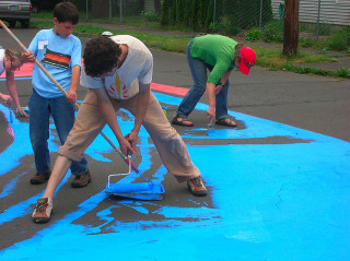 Painting residential intersections brings neighbors together in Portland -- and it's fun for kids.