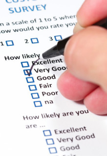 person completing a survey form