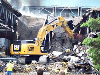 Bulldozers clear debris from destroyed portions of Verso paper mill. photo courtesy City of Sartell.