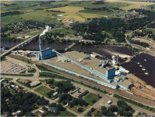 Aerial view of the paper mill complex and hydro facility.