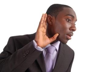photo of a man listening