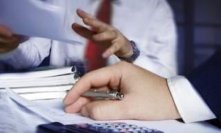 Business person using a calculator
