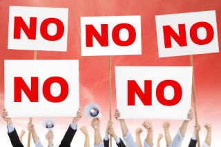 """illustration of crowd of people holding """"NO"""" signs"""