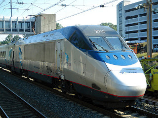 Amtrak Acela train at BWI Airport Station between Baltimore and Washington, DC. Photo by Michael Renner; Flickr Creative Commons license.
